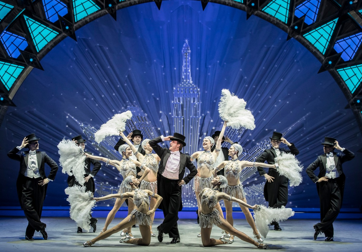 Haydn Oakley, centre, with the cast of An American in Paris at the Dominion Theatre CREDIT Johann Persson.jpg