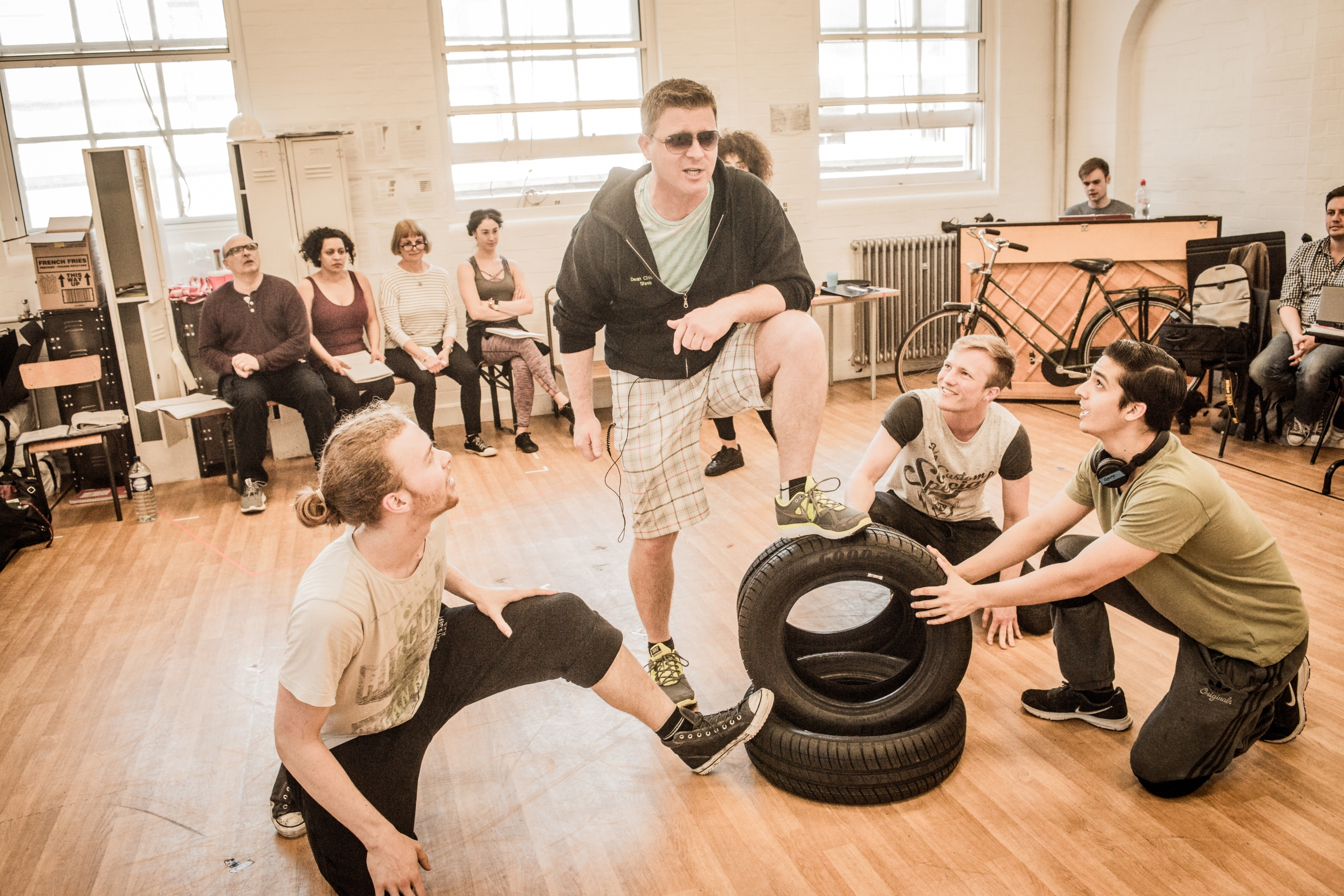 Dean Chisnall (centre) in rehearsals for WORKING, credit Robert Workman.jpg