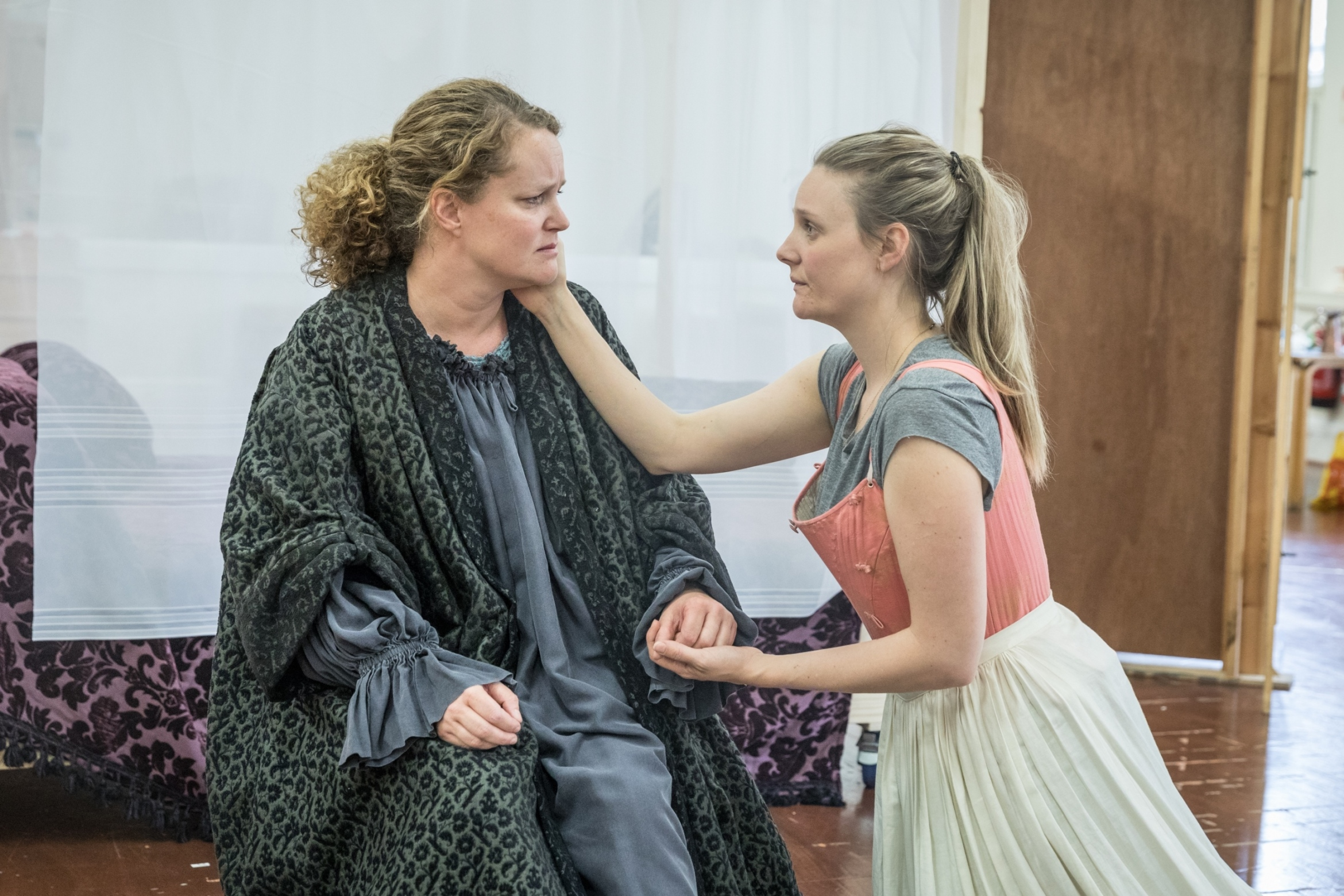 Emma Cunniffe as Queen Anne and Romola Garai as Sarah Duchess of Marlborough in rehearsals for Queen Anne. Credit Marc Brenner
